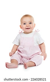 Smiling baby in pink jumpsuit sitting on the floor isolated on white background