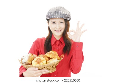 Smiling baker with breads