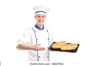 Smiling baker showing freshly baked breads isolated on white background