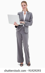 Smiling bank employee with laptop against a white background