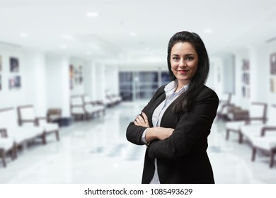 Smiling bank manager welcoming warm personality bright big smile in large building.