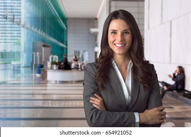 Smiling bank manager welcoming warm personality bright big smile in large building