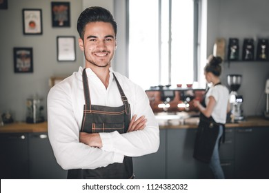 Smiling barista in apron, Coffee business owner