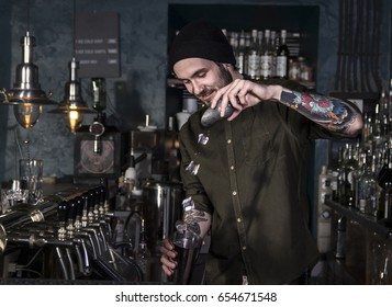 Smiling bartender is making a cocktail