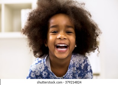 Smiling beautiful african girl with healthy white teeth