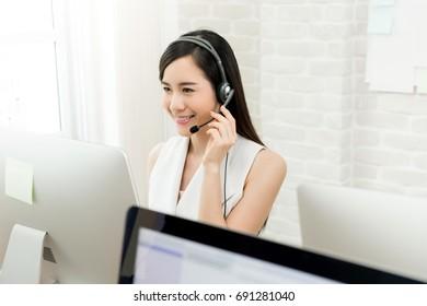 Smiling beautiful Asian woman telemarketing customer service agent, call center job concept