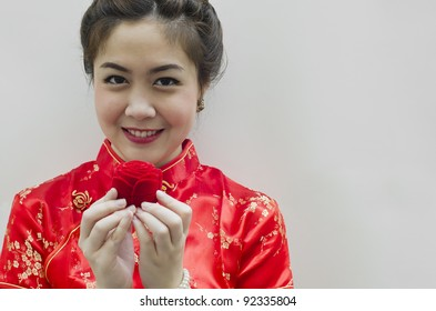 smiling beautiful chinese woman holding the rose