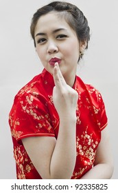 smiling beautiful chinese young woman gesturing with tradition clothing