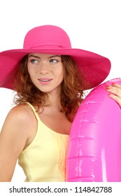 Smiling beautiful girl with beach hat  and rubber ring isolated on white