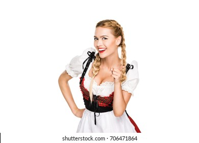 smiling beautiful girl in traditional german outfit pointing at you, isolated on white