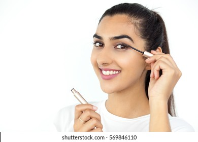 Smiling Beautiful Indian Lady Applying Mascara