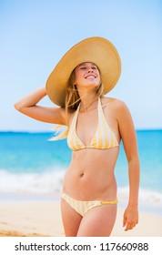 Smiling Beautiful Sexy Young Woman at the Beach in Bikini