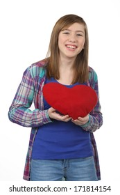 Smiling beautiful teenage girl with a red heart on Valentine's Day isolated on white background