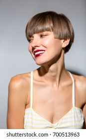 Smiling beautiful woman with brown short hair. Haircut. Hairstyle. Fringe. Professional makeup and tanned skin
