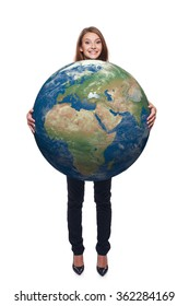 Smiling beautiful woman in full length holding earth globe in her hands, Africa and Europe in front, over white background