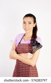 Smiling Beautiful Woman holding Cooking Equipment on White Background, Cooking Concept