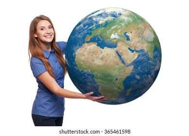 Smiling beautiful woman holding earth globe in her hands, Africa and Europe in front, over white background
