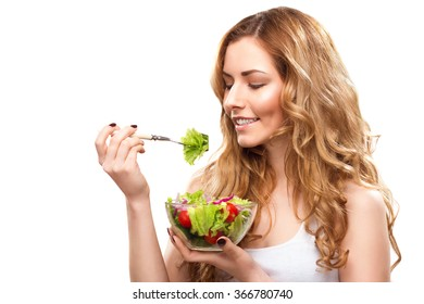Smiling Beautiful Woman Looks At A Lettuce Leaf Isolated On White Background. Healthy Eating Theme