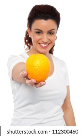 Smiling beautiful woman offering you an orange. Eat healthy, stay fit