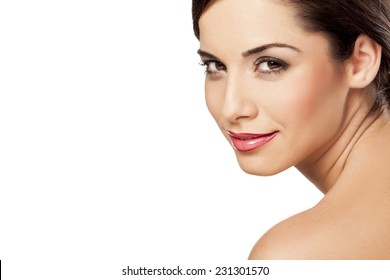 smiling beautiful woman posing on a white background