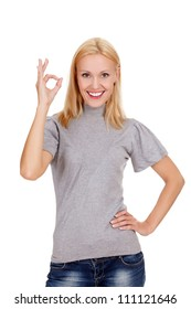 smiling beautiful woman showing okay gesture, isolated on white background