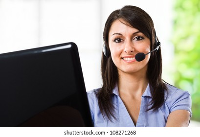 Smiling beautiful woman using an headset