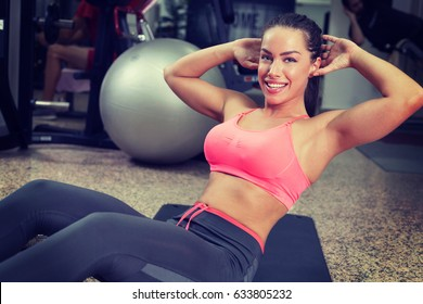 Smiling beautiful young woman exercising