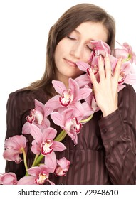 smiling beautiful young woman with pink orchid