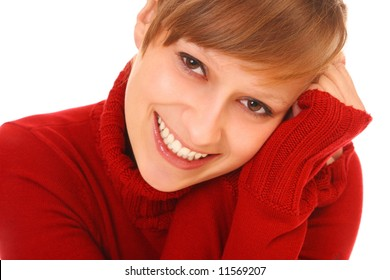 Smiling beautiful young woman  in red sweater on white background