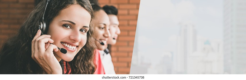 Smiling beautiful young woman telemarketing customer service agent working in call center office with her team - horizontal web banner with copy space