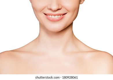 Smiling beauty. Cropped image of beautiful young shirtless woman smiling while isolated on white background