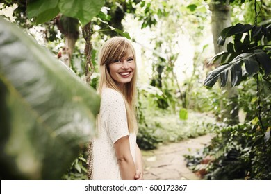 Smiling beauty in garden looking at camera
