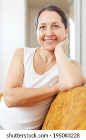 smiling beauty mature woman in home interior