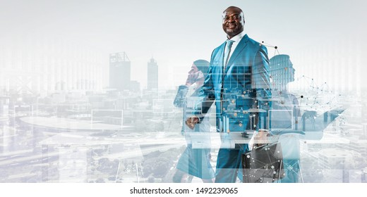 Smiling black businessman standing against a cityscape and graphic background