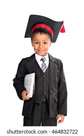 Smiling black seven years boy in school uniform and graduate cap isolated on white.