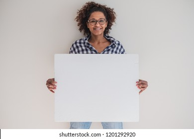 Smiling black woman showing white empty banner