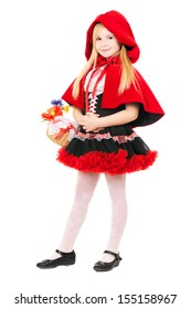 Smiling blond girl posing in a dress of little red riding hood. Isolated on white
