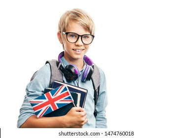 Smiling blond kid in glasses is about to learn English