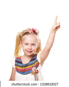 smiling blond little girl pointing upward isolated