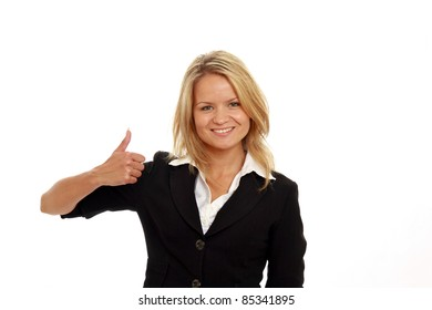 Smiling blonde businesswoman showing thumb up isolated