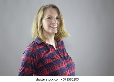 Smiling Blonde Female In Flannel Shirt