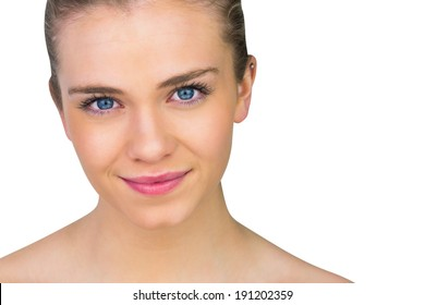 Smiling blonde natural beauty on white background