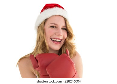 Smiling blonde wearing red boxing gloves on white background