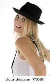Smiling blonde woman in retro clothing reminiscent of 1940's menswear and strings of pearls