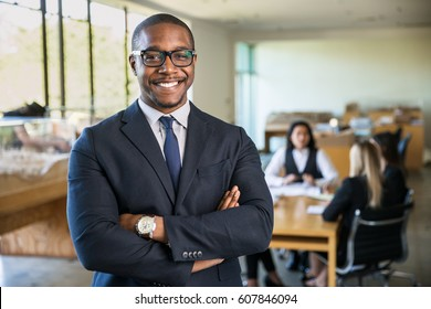 Smiling boss ceo at office work place portrait of worker in suit glasses and tie looking handsome