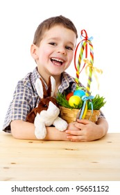 Smiling boy with easter eggs and bunny, isolated on white