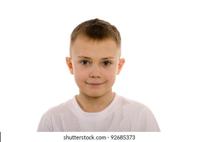Smiling boy of eight years from the front. Children's hairdo - a series of five photos.