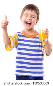 Smiling boy enjoying with glass of yellow juice, isolated on white