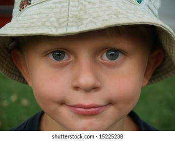 smiling boy in hat close-up