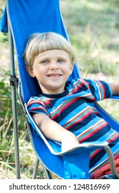 Smiling boy having picnic  in summer day
